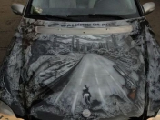 The Walking Dead aerografiado en un coche